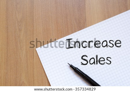 Increase sales text concept write on notebook with pen