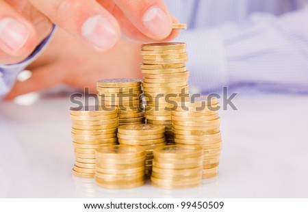 Increase your savings, hand holding coin - stock photo