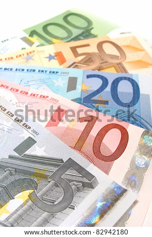 Increasing denominations of Euro notes arranged in a fan background
