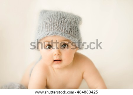 Incredible and charming newborn baby lying on a white background