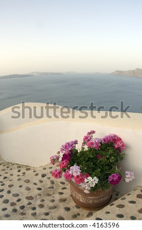 incredible santorini view with flowers on staircase over the sea - stock photo