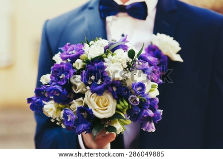 incredibly beautiful elegant stylish bridal bouquet with roses and purple flowers - stock photo
