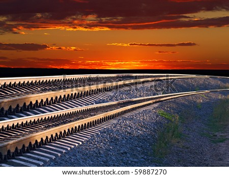 Incredibly beautiful landscape of railroad tracks and the sunset - stock photo