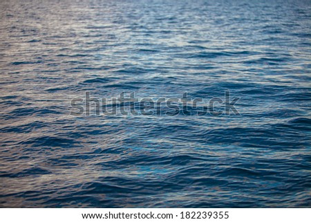 Incredibly clean turquoise water in the sea near tropical island - stock photo