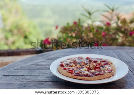 Incredibly delicious strawberry pizza . Pizza with strawberries . Original pizza with cheese and strawberries on wooden table - stock photo