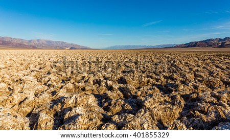 Incredibly serrated spires of salt. Salt has created complex structures. A large salt pan on the floor of Death Valley. Devil's Golf Course, Death Valley National Park - stock photo