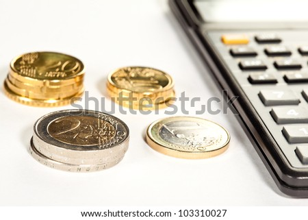 Increment of capital: euro coins and calculator