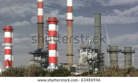 Increment works on a petrol refinery unity.Panorama picture,not a crop. - stock photo