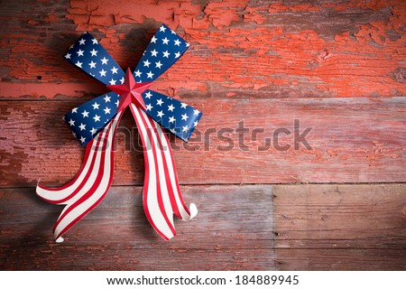 Independence Day 4th July emblem with a blue stars bow and curly red and white ribbon to celebrate the Declaration of Independence of the United States of America, copy space on the right - stock photo