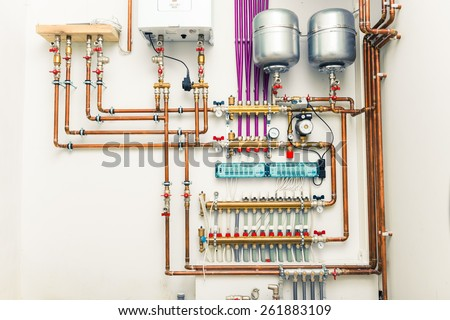 independent heating system in boiler-house - stock photo