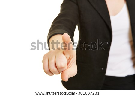 Index finger of female hand using virtual touchscreen - stock photo