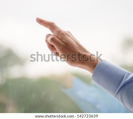 index finger shows the window - stock photo