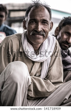 INDIA, AGRA, JULY 18:  Portrait of of an unidentified man sitting and participating to a debate about the creation of an hospital in the countryside and financed by Oxfam, July 18, 2010, India - stock photo