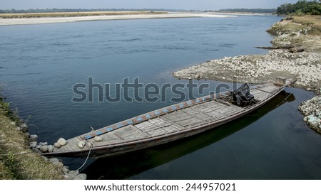 INDIA, ASSAM, MANAS NATIONAL PARK - NOVEMBER, 2014: Traditional wooden Indian boat on the Beki river in Manas