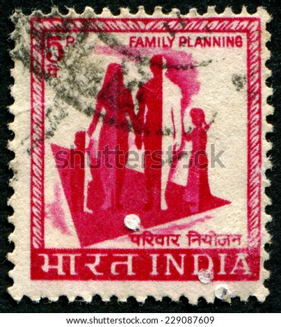 "INDIA - CIRCA 1965: A stamp printed in India shows image of a family with the inscription ""family planning"", series, circa 1965 - stock photo"