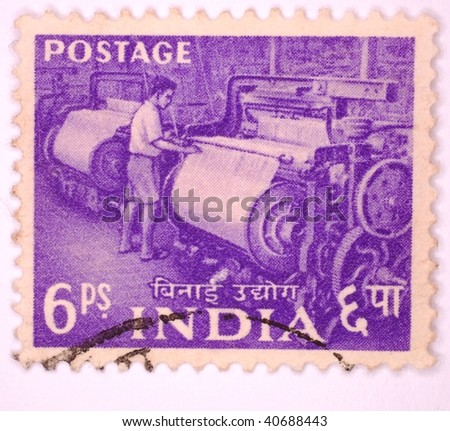 INDIA - CIRCA 1923: A stamp printed in India shows image of an Indian man working a weaving loom, series, circa 1923 - stock photo