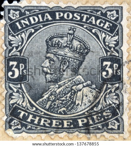 INDIA - CIRCA 1934: A stamp printed in India shows King George V, circa 1934 - stock photo