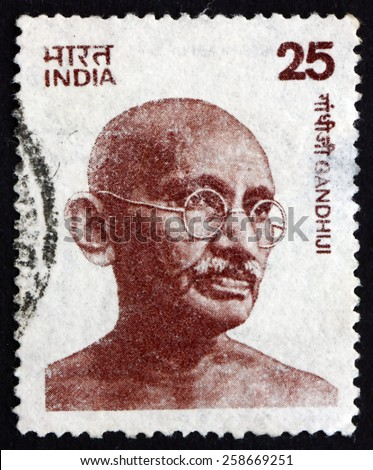 INDIA - CIRCA 1979: a stamp printed in India shows Mahatma Gandhi, portrait, leader of Indian independence movement in British-ruled India, circa 1979 - stock photo