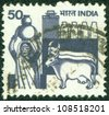 INDIA - CIRCA 1965: A stamp printed in India shows Woman with a jug of milk and cows, circa 1965 - stock photo
