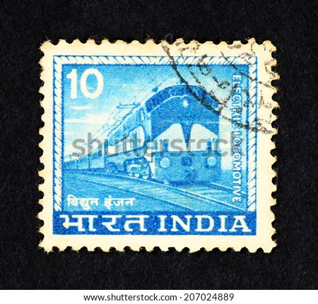 INDIA - CIRCA 1965: Blue color postage stamp printed in India with image of an electric locomotive.