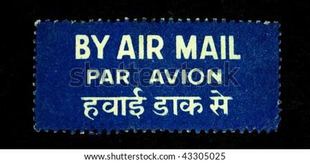 INDIA - CIRCA 1950s: By Air Mail - sticker with the words in English, French and Sanskrit, circa 1950s