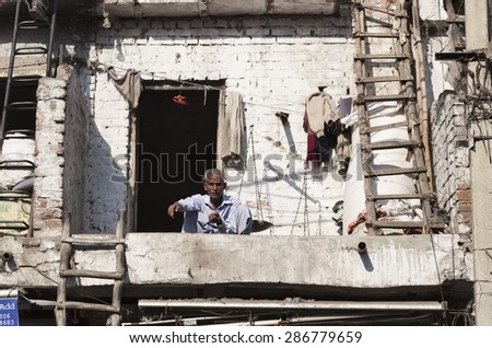 INDIA, Delhi; 21 january 2007, indian man in front of his house - EDITORIAL - stock photo