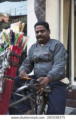 INDIA, Delhi, street knife grinder - EDITORIAL - stock photo