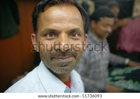 INDIA - FEB 26: Portrait of factory supervisor in a small factory in Old Delh on February 26, 2008 in Delhi, India. Many small factories provide the West with their clothes. - stock photo