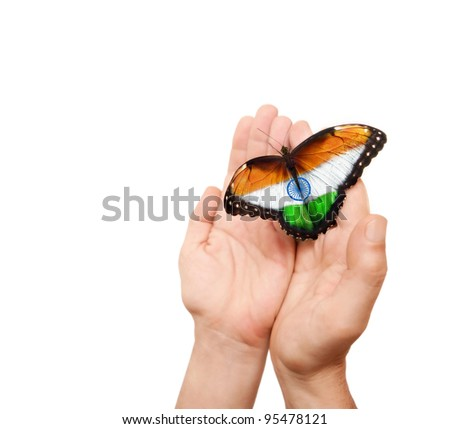 India flag butterfly on a man's hands. - stock photo