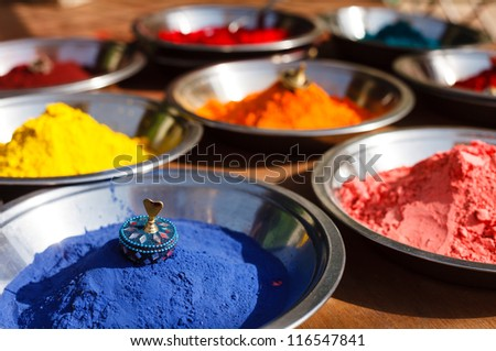 India Holi symbol. Colored colorful powder kumkum in bowls on Indian bazaar for Holi and other festivals celebration - stock photo