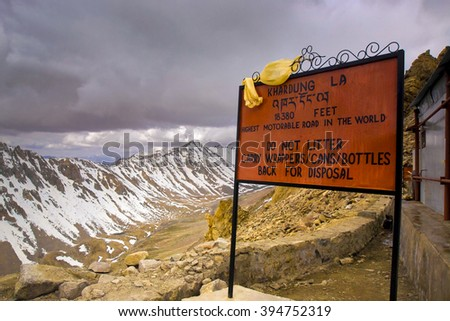 INDIA, LADAKH, 2006-02-29: Notice sign with admonition to avoid litter on Khardung La Pass on the highest motor able mountain road of the world between Leh and Nubra Valley.