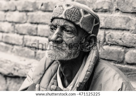 INDIA,MANALI - 11 June 2015: local person's portrait, the village of Manali. Himachal Pradesh - Himalayas. Black and white photo.