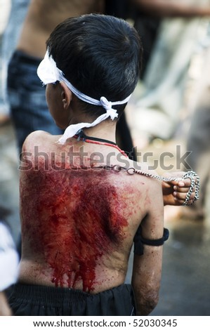 INDIA - MUHARRAM DECEMBER 28:In Muharram people beat their chest and followers practice self-flagellation, drawing blood 28 December,2009 in Chennai, India