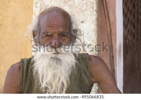 India - near Khajuraho - (24/02/2016). A holy man, sadhu, watcher of a temple,  looking into the camera.