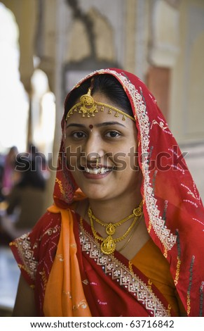 India, Rajasthan, Jaipur, an indian woman in an hindu temple near Sisodia Rani Ka Bagh Palace - stock photo
