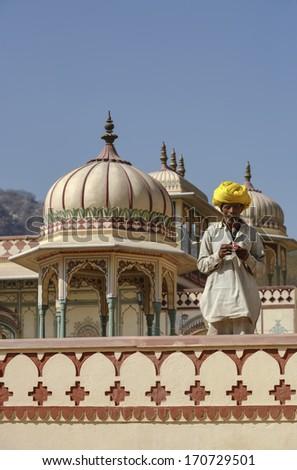 India, Rajasthan, Jaipur, indian man at the Sisodia Rani Ka Bagh Palace, built in 1710 A.D. by Maharaja Sawai Jai Singh - stock photo