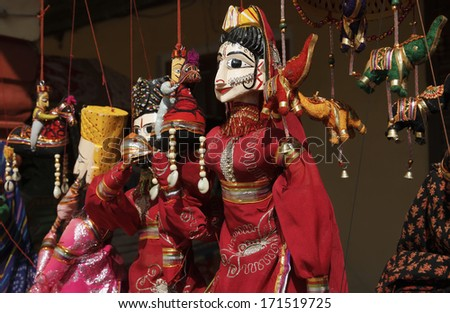 India, Rajasthan, Jaipur, indian wooden puppets for sale in a local market