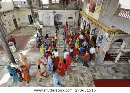 India, Rajasthan, Jaipur; 25 january 2007, indian people in a hindu temple near Sisodia Rani Ka Bagh Palace - EDITORIAL - stock photo
