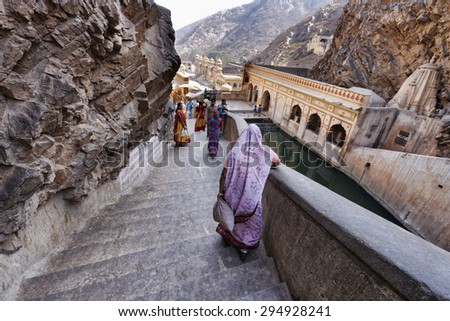 India, Rajasthan, Jaipur; 25 january 2007, people at Galta Hindu Temples, 11 km away from Jaipur  - stock photo