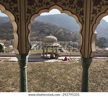 India, Rajasthan, Jaipur; 24 january 2007, Sisodia Rani Ka Bagh Palace, built in 1710 A.D. by Maharaja Sawai Jai Singh, indian women in the garden - EDITORIAL - stock photo