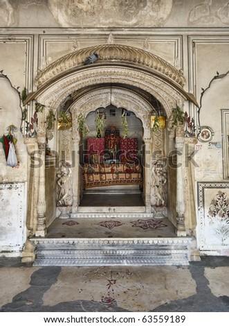 India, Rajasthan, Jaipur, Sisodia Rani Ka Bagh Palace, built in 1710 A.D. by Maharaja Sawai Jai Singh, small religious altair - stock photo