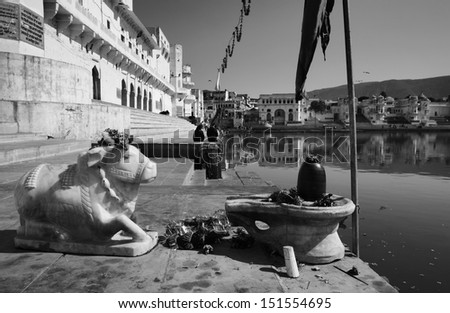 India, Rajasthan, Pushkar, view of the town and an old religious statue of a sacred cow - stock photo