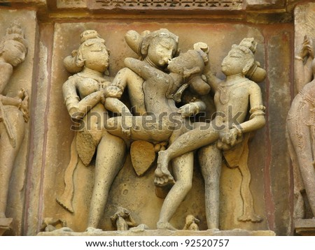 India: Temples of Khajuraho, one of the most popular tourist destinations in India, and famous for their erotic sculptures. Unesco World Heritage. - stock photo