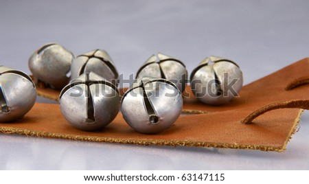 Indian ankel bells for dancing on blue gray background - stock photo