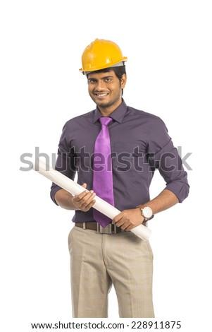Indian Architect holding blueprints isolated on white background. - stock photo