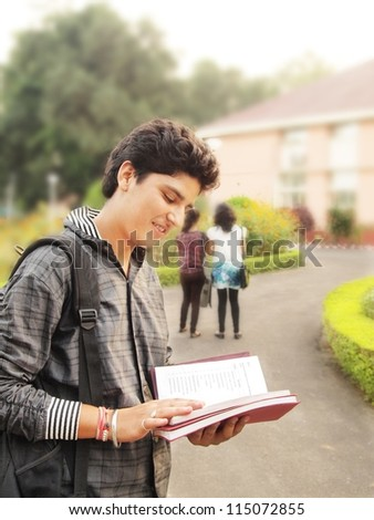 Indian / Asian college student studying on campus - stock photo