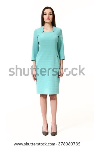 indian asian eastern brunette business executive woman with straight hair style in blue   dress full body length portrait standing isolated on white
