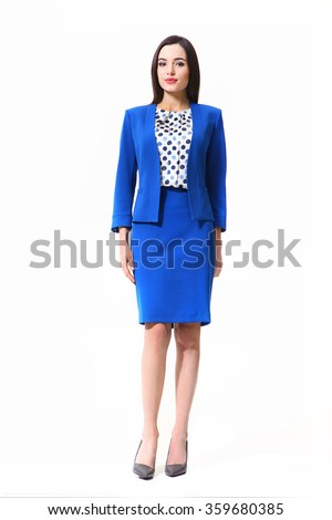 indian asian eastern brunette business executive woman with straight hair style in blue official suit skirt and jacket  high heels shoes full length body portrait standing isolated on white - stock photo