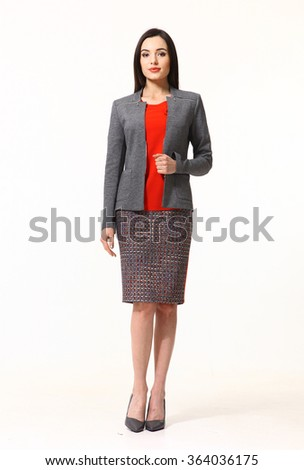 indian asian eastern brunette business executive woman with straight hair style in gray official jacket skirt two pieces suit heels shoes full length body portrait standing isolated on white - stock photo