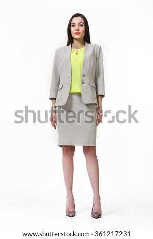 indian asian eastern brunette business executive woman with straight hair style in light gray jacket and skirt suit high heels shoes full length body portrait standing isolated on white - stock photo